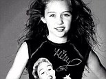 That's just creepy! Miley Cyrus posted this 'flashback' picture of her younger self wearing one of her more recent tour merchandise items on Sunday