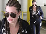 Korndashian? Khloe shows off long cornrows on way to gym... as rumors continue to swirl she's 'still in love with Lamar Odom'