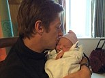 It's a girl! Man Men star Kevin Rahm, 43, welcomes daughter with touching Twitter photo from hospital