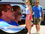 I'll be back! Arnold Schwarzenegger's girlfriend Heather Milligan waits patiently to be picked up for romantic drive in LA