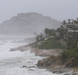 Waves hit the coast of Los Cabos, Mexico,  Sunday, Sept. 14, 2014. Hurricane Odile turned into a Category 4 hurricane and it's expected to make a close brush with the southern portion of Mexico's Baja California peninsula Sunday evening. (AP Photo/Victor R. Caivano)