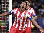 Atletico Madrid's Falcao celebrates after scoring a third goal against Chelsea during their UEFA Super Cup match at Louis II stadium in Monaco, August 31, 2012.    REUTERS/Eric Gaillard (MONACO - Tags: SPORT SOCCER)