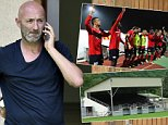 """France's Fabien Barthes (L), managing director of the football club of Luzenac speaks on the phone during a training session in Toulouse, southern France, on August 8, 2014, after learning his club was refused promotion to the Ligue 2. The French Professional Football League (LFP) on August 8 ruled Luzenac could not take their place in the French second division, the Ligue 2, after being promoted from the third tier of French football last season. The ruling said: """"The club does not have a ground which conforms to the required safety standards.""""  AFP PHOTO / PASCAL PAVANI        (Photo credit should read PASCAL PAVANI/AFP/Getty Images)"""