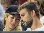 epa04393074 Colombian singer Shakira (L) and FC Barcelona soccer team player Gerard Pique (R) watch the FIBA Basketball World Cup quarter final match between Slovenia and USA played at Sant Jordi Palace in Barcelona, northeasthern Spain, on 9 September 2014.  EPA/ANDREU DALMAU