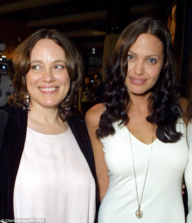 Adoring: Angelina Jolie - seen with her late mother Marcheline Bertrand in July 2001 - wore a locket with Marcheline's picture as she walked down the aisle to marry Brad Pitt last Saturday