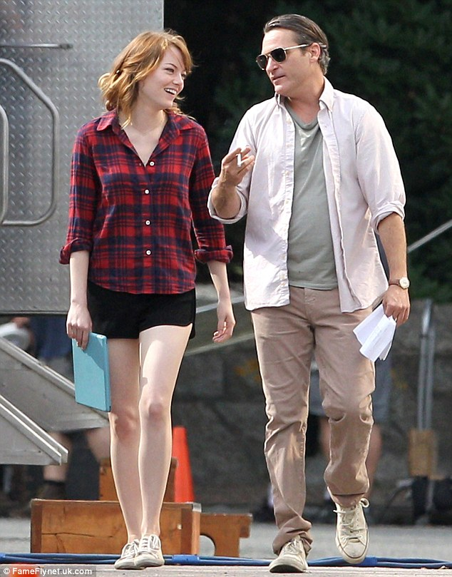 Working on new movie: Joaquin Phoenix shares a laugh on set with co-star Emma Stone on August 14 while they shoot an untitled Woody Allen project due for release in 2015