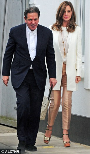 Defeated: Charles Saatchi with his new girlfriend Trinny Woodall