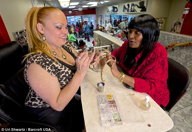 LaRue gets her nails decorated with long nail technician Maria Ortiz at Maria's Nails in Newark, New Jersey