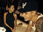 The look of love! Selena Gomez cannot keep her eyes or hands off Justin Bieber during a bowling birthday party