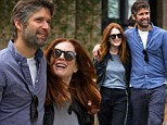 It must be love! Julianne Moore and husband Bart Freundlich tenderly hold each other during romantic stroll in NYC
