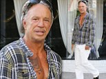 Trying to find space? Mickey Rourke leaves his shirt unbuttoned flashing his inked up chest as he heads to the tattoo parlour
