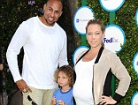 Taking him back: Kendra Wilkinson has reportedly allowed Hank Baskett to move back into their home, pictured in April with their oldest child