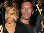 PICTURE EXCLUSIVE: Jennifer Lawrence attempts to go incognito behind her handbag as she leaves Coldplay concert after Chris Martin 'serenades' her