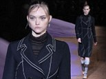 Back in black! Australian supermodel Gemma Ward, 26, returns to catwalk after six year hiatus and the birth of her baby to strut her stuff in Prada fashion show