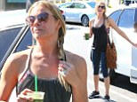LeAnn Rimes clutches healthy green drink after teaming loose-fitting cut-out top with fringed handbag