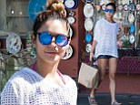 Vanessa Hudgens shows off her long legs in TINY patterned shorts as she beats the LA heatwave with an iced drink