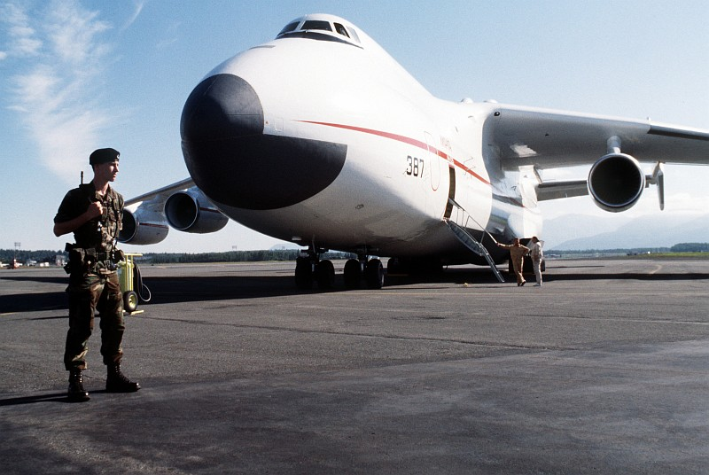 """7. A United States Airman First Class (A1C) of the 21st Security Police Squadron Guards the Antonov An-225 Mriya (""""Cossak""""), a Heavy Transport Aircraft, As It Sits On the Flight Line, August 1989, Elmendorf Air Force Base, State of Alaska, USA. Photo Credit: SSgt. Kevin L. Bishop, United States Air Force (USAF, http://www.af.mil); Defense Visual Information Center (DVIC, http://www.DoDMedia.osd.mil, DFST9005773) and United States Air Force (USAF, http://www.af.mil), United States Department of Defense (DoD, http://www.DefenseLink.mil or http://www.dod.gov), Government of the United States of America (USA)."""