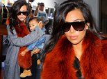 Kim Kardashian and daughter Nori catch a flight from LAX to Kanye's home town of Chicago. September 22, 2014 X17online.com