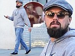 """U.S actor Leonardo DiCaprio is walking with friends after having lunch at """"Laduree"""" restaurant in Soho, New York, NY on September 22, 2014.\nPhoto by Morgan Dessalles/ABACAUSA.COM"""