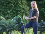 Land of plenty: Helen Frear grows her own Brussels sprouts, beans and onions on an allotment