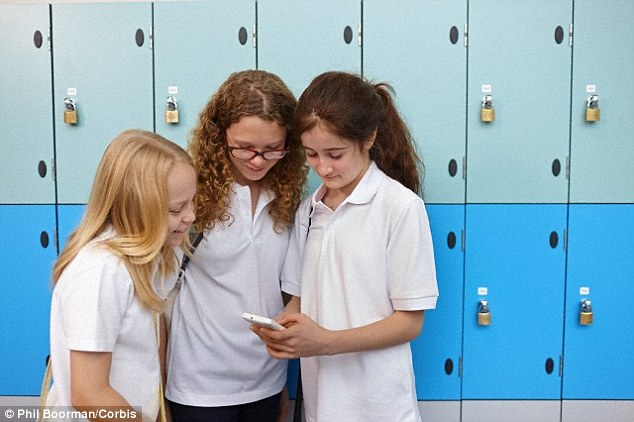 Research has found that the average school bag now contains £130 worth of gadgets. Almoist half of school children take a mobile phone to school (illustrated with a stock image) 26 per cent own smartphones, 22 per cent own feature phones - and 8 per cent regularly take tablets