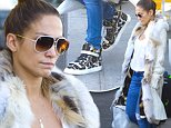 EXCLUSIVE: Jennifer Lopez wearing a fur lined coat and her hair up in a bun arrives stateside at JFK airport after a successful performance at the Singapore Grand Prix.\n\nPictured: Jennifer Lopez\nRef: SPL848810  230914   EXCLUSIVE\nPicture by: Ron Asadorian / Splash News\n\nSplash News and Pictures\nLos Angeles: 310-821-2666\nNew York: 212-619-2666\nLondon: 870-934-2666\nphotodesk@splashnews.com\n