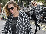 LONDON, ENGLAND - SEPTEMBER 23:  Kate Moss seen arriving at an office on September 23, 2014 in London, England.  (Photo by Neil P. Mockford/GC Images)