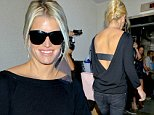 Jessica Simpson carries an oversized hand bag and shows off her pearly whites before flying from LAX to NYC. September, 23, 2014 X17online.com