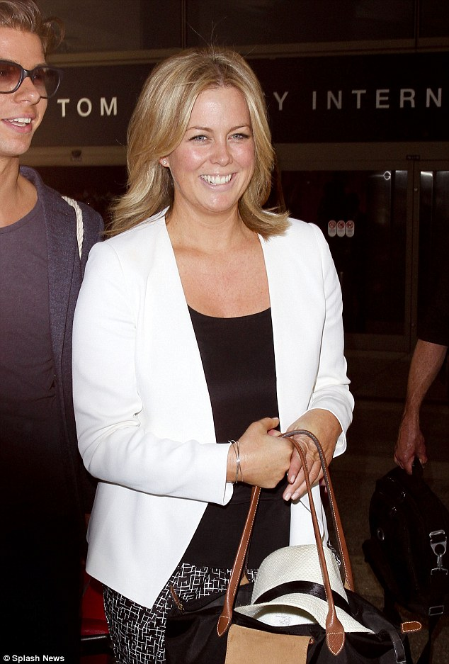 Dressed down chic: The host wore a white jacket, teamed with a black top and black and white graphic printed pants