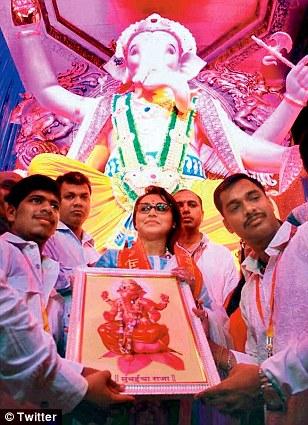 In the mood: Actress Rani Mukerji celebrates the festival at a South Mumbai pandal on Thursday