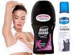 Woman in underwear using deodorant