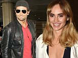 """Los Angeles, CA - Bradley Cooper makes it back to Los Angeles after a long international flight.  The actor enjoyed some time in London and spent time with his girlfriend Suki Waterhouse while filming his new movie """"Adam Jones"""".  Bradley signed some autographs for his fans while looking handsome in a black leather jacket, cool shades, and toting his own luggage. AKM-GSI          September 23, 2014 To License These Photos, Please Contact : Steve Ginsburg (310) 505-8447 (323) 423-9397 steve@akmgsi.com sales@akmgsi.com or Maria Buda (917) 242-1505 mbuda@akmgsi.com ginsburgspalyinc@gmail.com"""