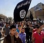 FILE - In this June 16, 2014 file photo, demonstrators chant pro-Islamic State group slogans as they carry the group's flags in front of the provincial government headquarters in Mosul, 225 miles (360 kilometers) northwest of Baghdad.  The Syrian foreign ministry said Tuesday, Sept. 23, 2014 that Washington informed Damascus' envoy to the United Nations before launching airstrikes against the Islamic State group in Syria, attacks that activists said inflicted casualties among jihadi fighters and civilians on the ground. (AP Photo, File)