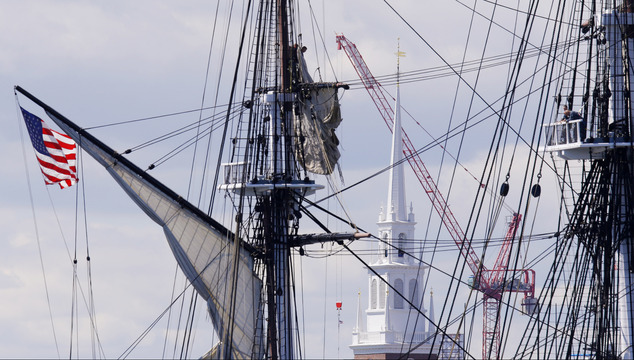 """The rigging of the U.S.S. Constitution, or """"Old Ironsides,"""" is seen against the steeple of the historic Old North Church as the ship is towed through Boston ..."""