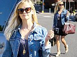 UK CLIENTS MUST CREDIT: AKM-GSI ONLY EXCLUSIVE: Reese Witherspoon looks cute and flirty after grabbing a bite to eat in Brentwood.  The 'Legally Blonde' showed off her toned legs in a short mini skirt topped with a purple tee and denim jacket.  Reese accessorized with a large Valentino studded tote.  Pictured: Reese Witherspoon Ref: SPL849342  230914   EXCLUSIVE Picture by: AKM-GSI
