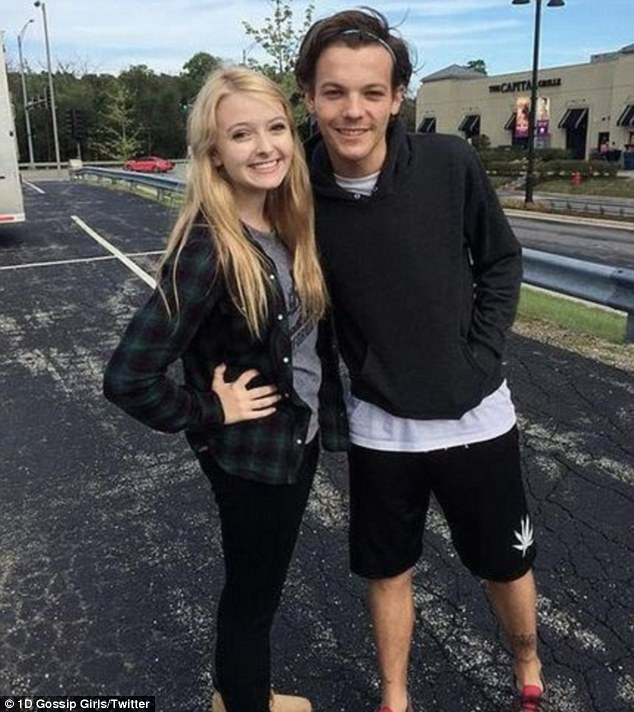 Hasn't learned his lesson: Louis Tomlinson, 22, donned a pair of shorts emblazoned with a marijuana leaf as he posed with a young fan in St. Louis, Missouri on Wednesday night