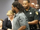 Jesse Leroy Matthew Jr. is escorted into a courtroom for an appearance before 405th District Court Judge Michelle Slaughter regarding his extradition back to Virginia Thursday, Sept. 25, 2014, in Galveston, Texas. Matthew Jr. was arrested on a beach in the Texas community of Gilchrist by Galveston County Sheriff's authorities. He is charged with abducting a missing University of Virginia sophomore and is awaiting extradition. (AP Photo/David J. Phillip)