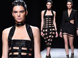 Kendall Jenner goes for semi-nude look as she walks the runway in risqué black Balmain lattice dress at Paris Fashion Week