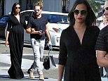EXCLUSIVE: Very beautiful and pregnant Zoe Saldana seen shopping at A Pea In The Pod with husband Marco.   Pictured: Zoe Saldana and Marco Perego Ref: SPL849682  240914   EXCLUSIVE Picture by: KAT / Splash News  Splash News and Pictures Los Angeles: 310-821-2666 New York: 212-619-2666 London: 870-934-2666 photodesk@splashnews.com