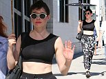 Rose McGowan looking very elegant under an umbrella, goes shopping at Chanel in Beverly Hills, CA.  Pictured: Rose McGowan Ref: SPL850523  240914   Picture by: Splash News  Splash News and Pictures Los Angeles: 310-821-2666 New York: 212-619-2666 London: 870-934-2666 photodesk@splashnews.com