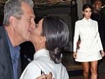 Kim Kardashian is a bit of all white in flirty miniskirt... as she shares awkward kiss with photographer Mario Testino