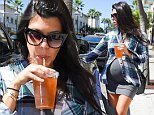 Beverly Hills, CA - Kourtney Kardashian shows off her baby bump as she heads back to her car after grabbing a bite at Nate 'n Al Delicatessen in Beverly Hills this afternoon.\nAKM-GSI       September 26, 2014\nTo License These Photos, Please Contact :\nSteve Ginsburg\n(310) 505-8447\n(323) 423-9397\nsteve@akmgsi.com\nsales@akmgsi.com\nor\nMaria Buda\n(917) 242-1505\nmbuda@akmgsi.com\nginsburgspalyinc@gmail.com
