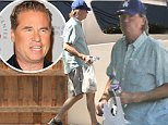 EXCLUSIVE TO INF. ALL-ROUNDER.\nSeptember 24, 2014:  Val Kilmer is seen as he clears out his car and takes some of his bags into his home today in Los Angeles, California.\nMandatory Credit: INFphoto.com Ref: infusla-277