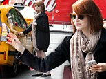 Actress Emma Stone hails a yellow cab on Park Avenue in New York, NY on September 24, 2014.