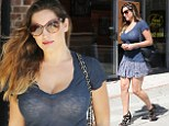 Kelly Brook leaves little to the imagination in plunging sheer T-shirt and ruffled miniskirt as she soaks up the LA sunshine