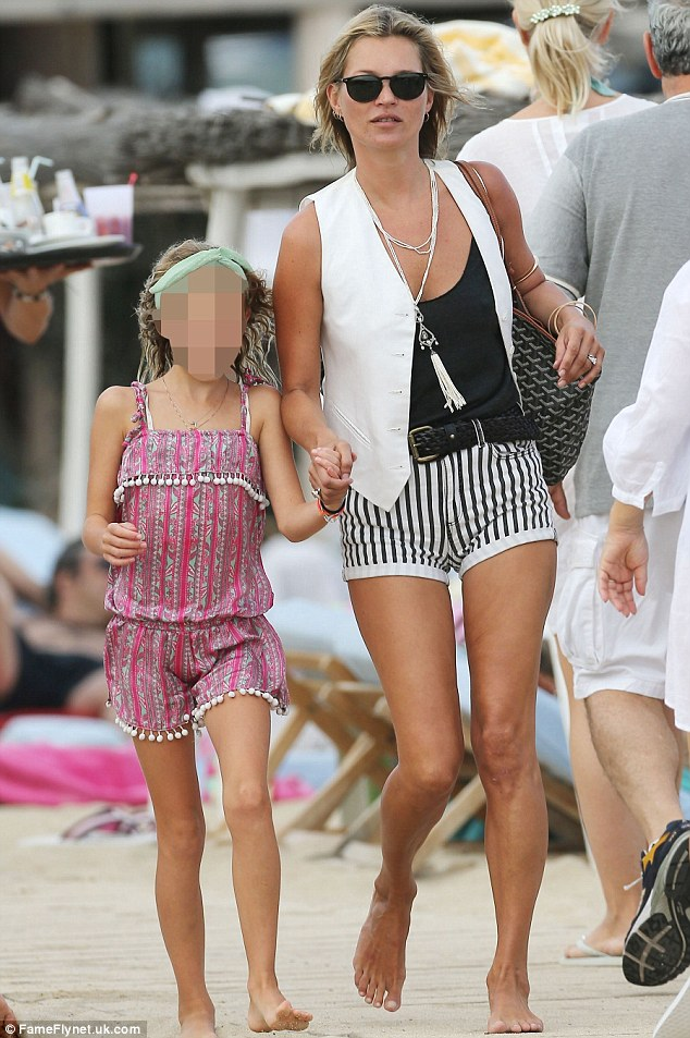 Playing mum: Kate Moss strolls in St. Tropez today with her daughter Lila Grace