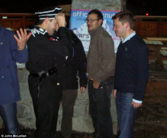 Proof: MP Aidan Burley (far right) leaves the Val Thorens pub with pal Mark Fourmier dressed in SS uniform