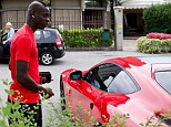 Balotelli (left) was pictured outside his Ferrari F12 Berlinetta whilst in Milan