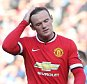 MANCHESTER, ENGLAND - SEPTEMBER 27:  Wayne Rooney of Manchester United walks off after being sent off during the Barclays Premier League match between Manchester United and West Ham United at Old Trafford on September 27, 2014 in Manchester, England.  (Photo by Matthew Peters/Man Utd via Getty Images)