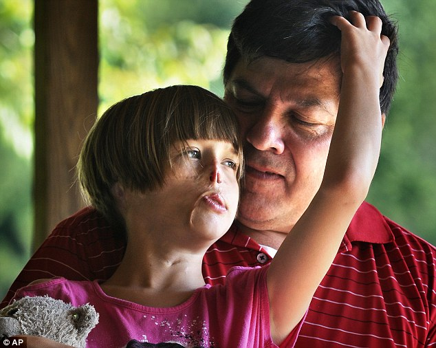 Loving family: Charlotte Ponce with her father, Tim, at a park in Nunica, Michigan